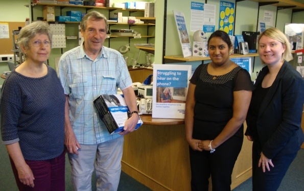 With Duncan Campbell and his wife, who were loaned an amplified cordless phone to try out, with Malaika Rose from Action on Hearing Loss Scotland